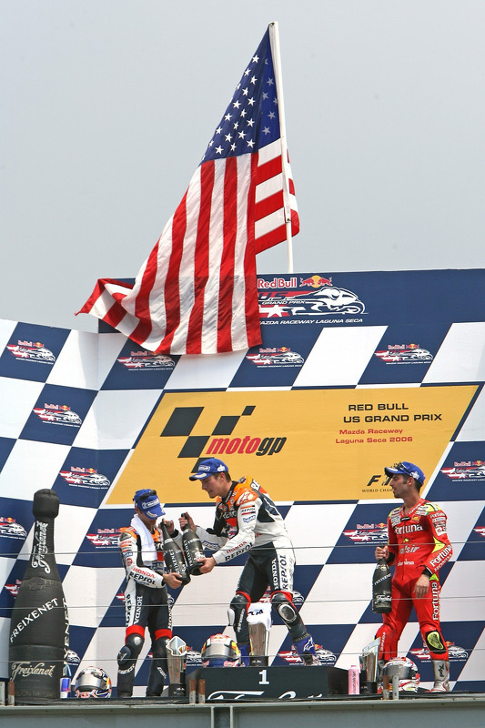 Podium: race winner Nicky Hayden with Dani Pedrosa and Marco Melandri
