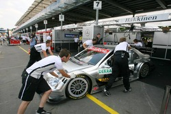 Mechanics push the car of Mika Hakkinen