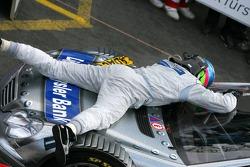 Race winner Bruno Spengler celebrates