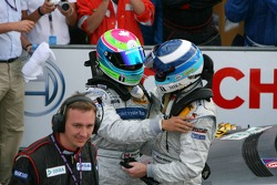 Race winner Bruno Spengler celebrates with Mika Hakkinen
