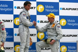 Podium: Mika Hakkinen congratulates race winner Bruno Spengler