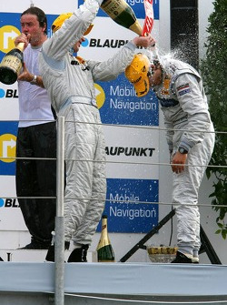 Podium: Mika Hakkinen gives race winner race winner Bruno Spengler a champagne shower