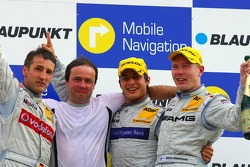 Podium: race winner Bruno Spengler with Bernd Schneider and Mika Hakkinen
