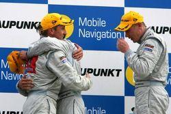 Podium: race winner Bruno Spengler with Bernd Schneider and Mika Hakkinen