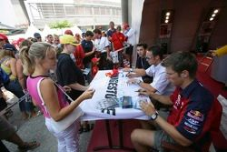 Michael Ammermuller, Andreas Zuber and Timo Glock sign autographs