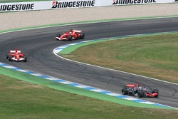 Kimi Raikkonen leads Michael Schumacher and Felipe Massa