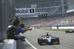 Timo Glock crosses the line to win the race