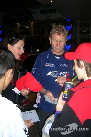 Driver Brad Jones signs autographs for 'Variety Kids'
