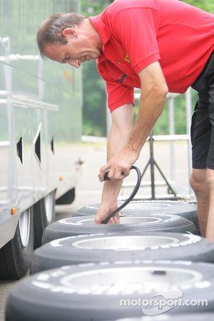 A Dams crew member checks tyres