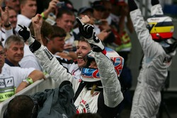 Race winner Jenson Button celebrates with Nick Fry and Pedro de la Rosa
