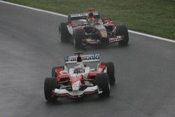 Jarno Trulli leads Vitantonio Liuzzi