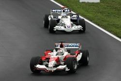 Jarno Trulli leads Nick Heidfeld