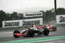 Kimi Raikkonen leads Tiago Monteiro