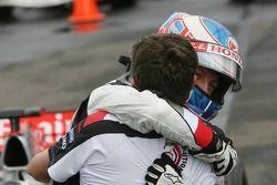Race winner Jenson Button celebrates with Nick Fry