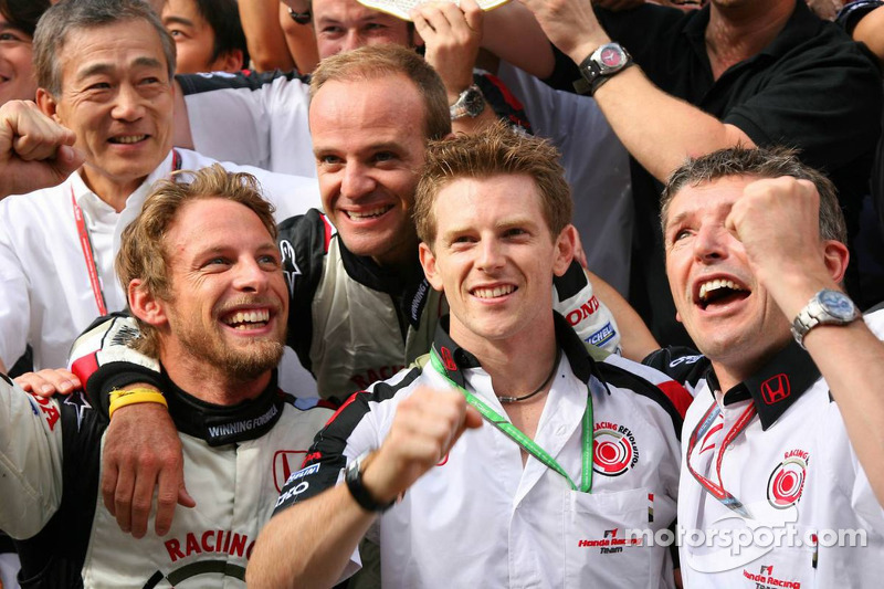 Race winner Jenson Button celebrates with Rubens Barrichello, Anthony Davidson and Honda Racing F1 team members