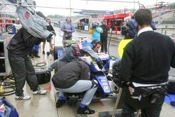 Adam Carroll pits to change a damaged front wing