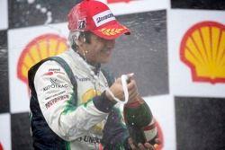 Nelson A. Piquet race winner sprays champagne