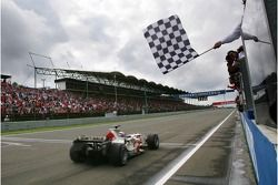 Jenson Button takes the chequered flag