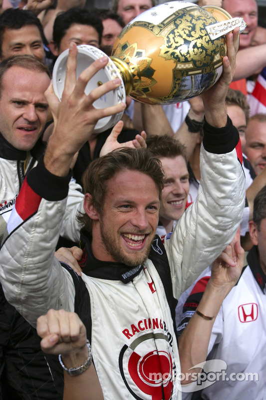 Race winner Jenson Button celebrates with Honda Racing F1 team members