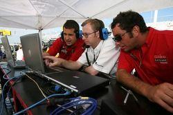 Gainsco/ Blackhawk Racing crew members watch qualifying