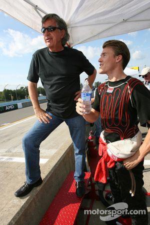 Alex Gurney watches qualifying