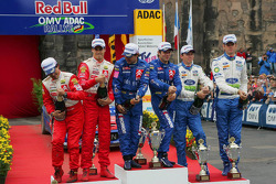 Podium: winners Sébastien Loeb and Daniel Elena, with second place Daniel Sordo and Marc Marti, and third place Marcus Gronholm and Timo Rautiainen