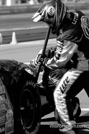 Miller Lite Dodge crew members repair the damage on the car of Kurt Busch
