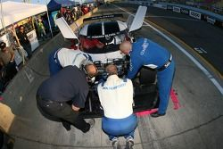 Rocketsports Racing crew members work on the Ford Crawford