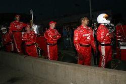 Chip Ganassi crew members watch the last lap