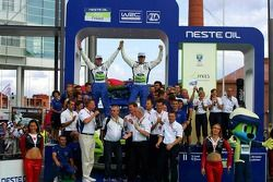 Podium: race winners Marcus Gronholm and Timo Rautiainen celebrate with BP Ford team members