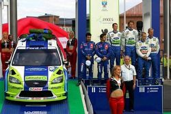 Podium: race winners Marcus Gronholm and Timo Rautiainen with second place Sébastien Loeb and Daniel