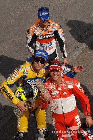 Podium: 1. Loris Capirossi, 2. Valentino Rossi, 3. Dani Pedrosa