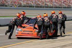 Crew members for Jeff Burton push the car to the garage after having problems with his car