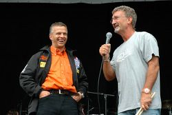Eddie Jordan and Jan Lammers on stage discussing a Dutch F1 team and Grand Prix