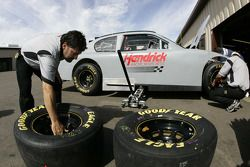 Hendrick Motorsports team members work on one of their cars