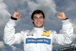 Pole winner Bruno Spengler celebrates