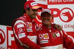 Podium: race winner Felipe Massa with Fernando Alonso and Michael Schumacher