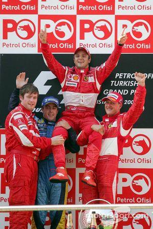 Podium: race winner Felipe Massa with Fernando Alonso, Michael Schumacher and Rob Smedly