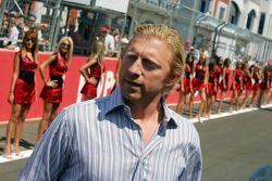Boris Becker with grid girls
