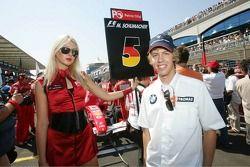 Sebastian Vettel with a grid girl