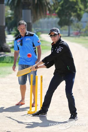 Sergio Perez, Sahara Force India F1 Team, plays cricket in Albert Park with Brad Hodge International