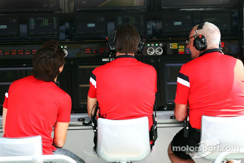 Roberto Merhi, Manor Marussia F1 Team; Graeme Lowdon, Manor Marussia F1 Team Chief Executive Officer; and John Booth, Manor Marussia F1 Team Team Principal on the pit gantry