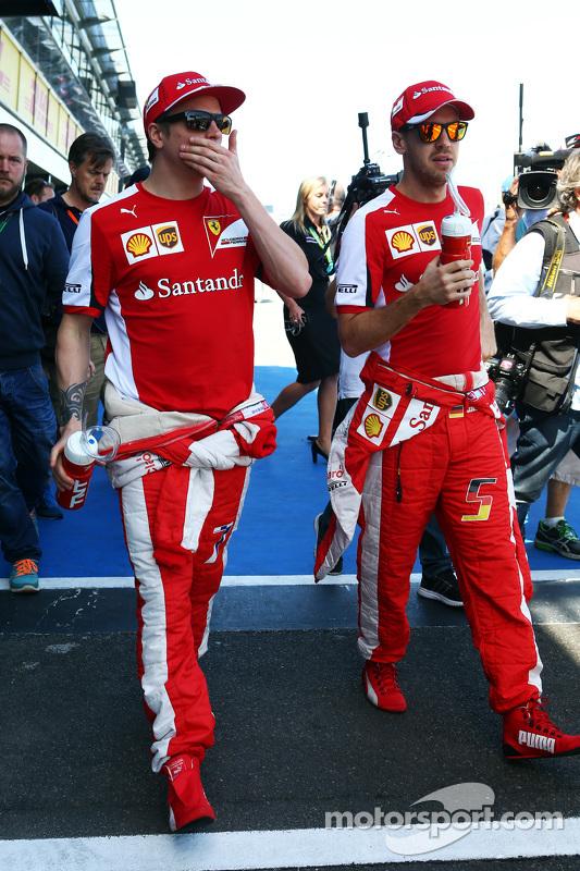 (从左到右)基米·莱库宁,法拉利车队和队友塞巴斯蒂安·维特尔,法拉利