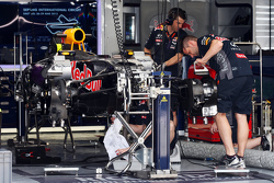 The Red Bull Racing RB11 is prepared in the pit garage