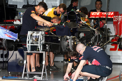The Scuderia Toro Rosso STR10 is prepared in the pit garage