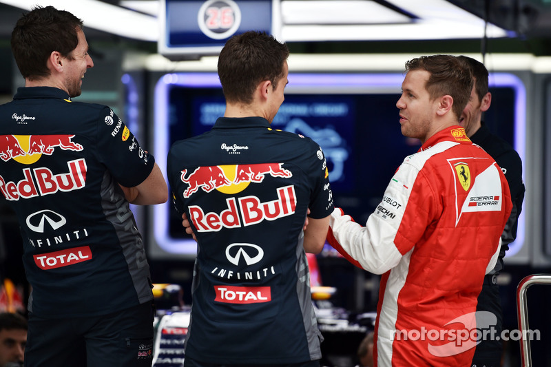 Sebastian Vettel, Ferrari visits the Red Bull Racing pit garage