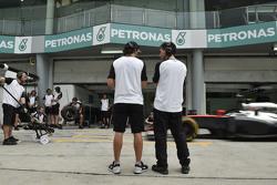 (L to R): Fernando Alonso, McLaren with Andrea Stella, McLaren Race Engineer
