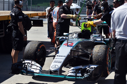 The Mercedes AMG F1 W06 of Lewis Hamilton, Mercedes AMG F1 is recovered back to the pits on the back of a truck in the first practice session