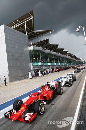 Kimi Raikkonen, Ferrari SF15-T in the queue at the end of the pit lane
