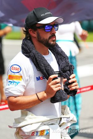 Fernando Alonso, McLaren as the grid observes the national anthem